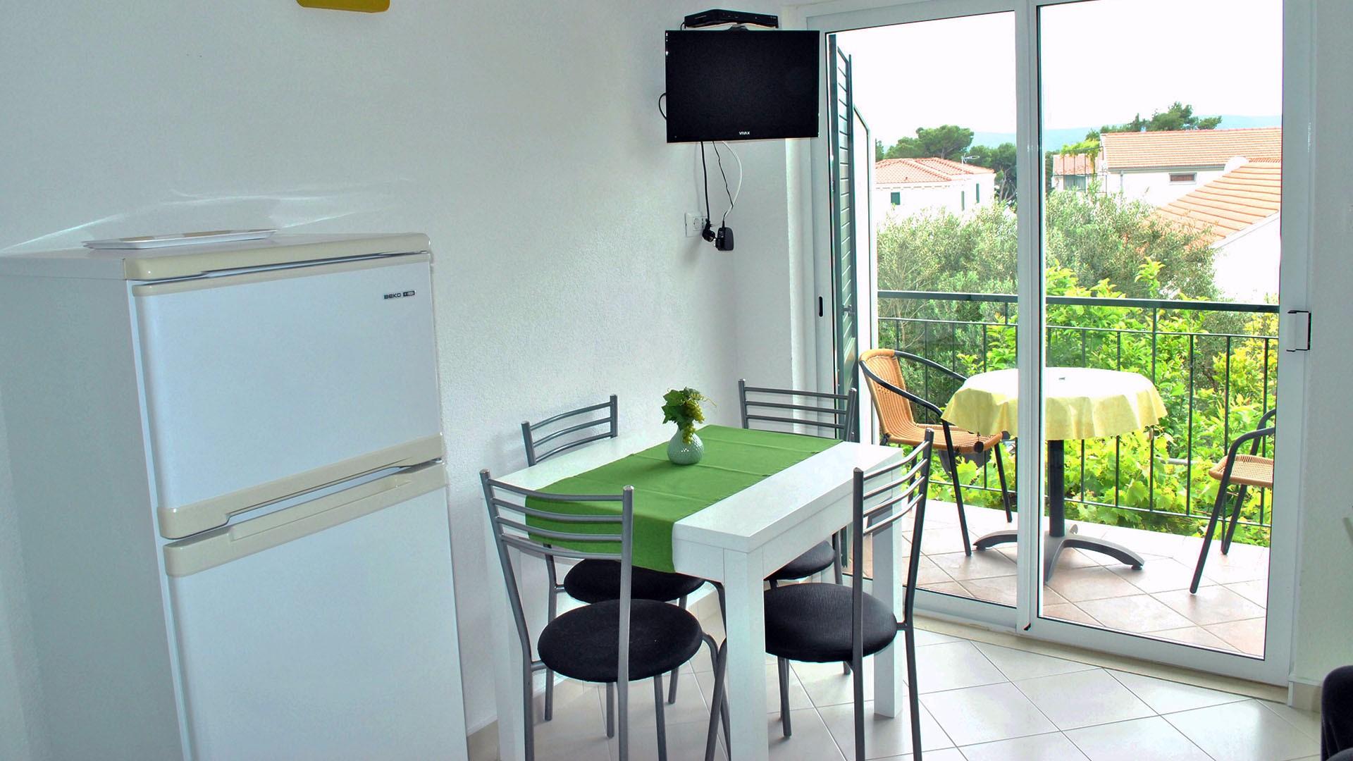 ApartmentA5 kitchen table and balcony